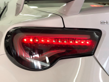 Picture of WSQ Valenti Style Smoked Sequential Taillights  w/ Black housing and White Bar